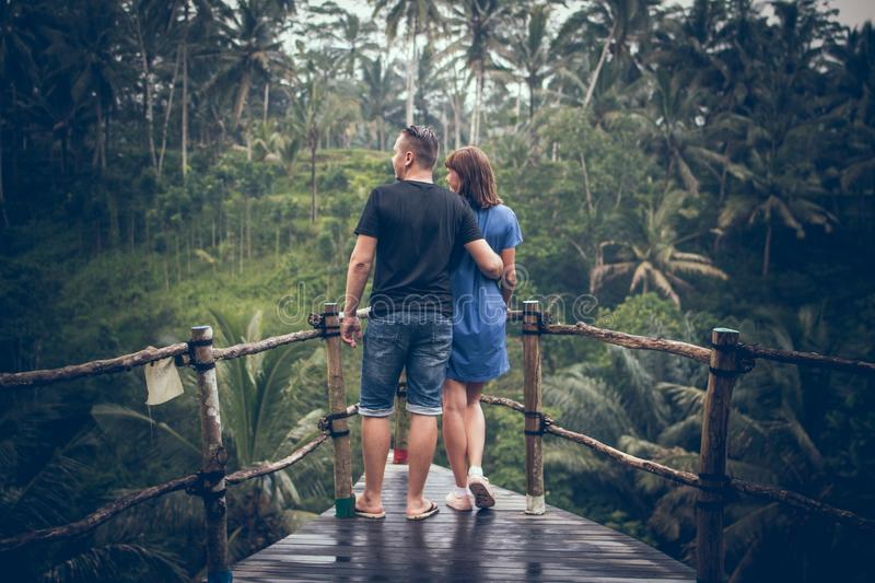 Man and Woman Standing on Hanging Bridge stock photography