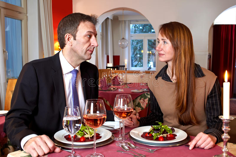 Download Man And Woman Staring At Each Over A Meal Stock Photo - Image: 26751910