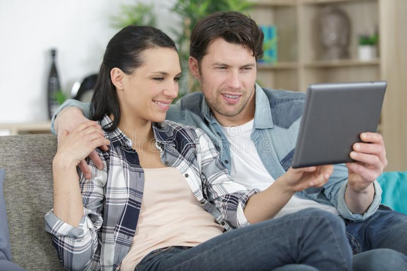 Man and woman with tablet stock image