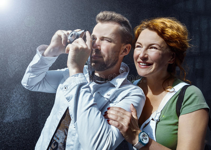 Man and woman taking picture on vintage camera, day, outdoor stock photos