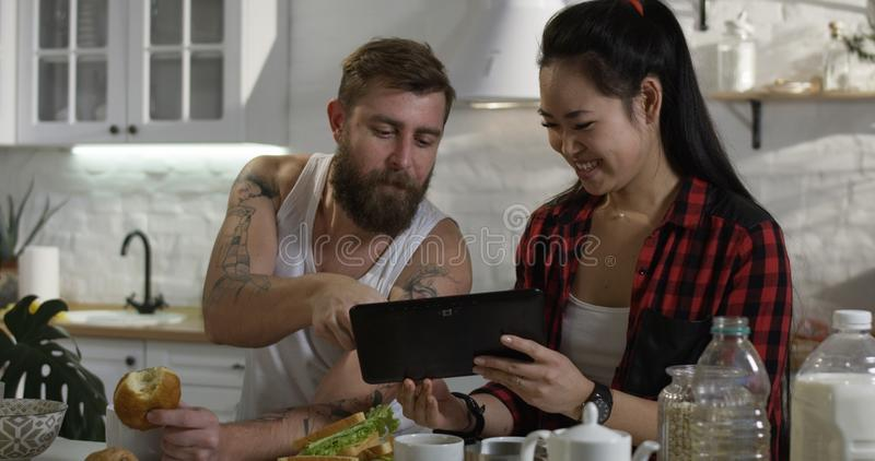 Man and woman talking during breakfast stock photo