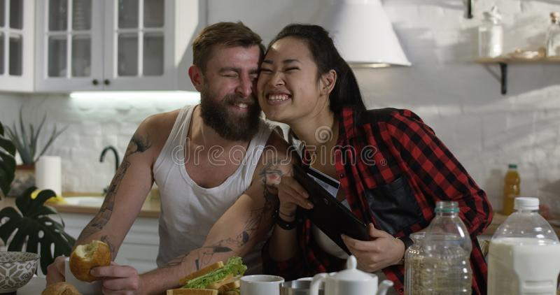 Man and woman talking during breakfast stock image