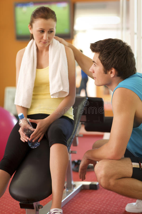 Man and Woman Talking in Health Club stock photos