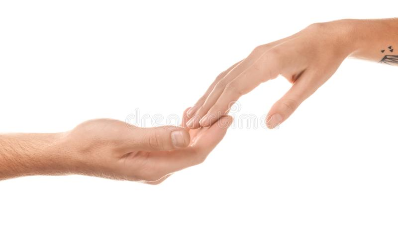Man and woman touching fingers on white background royalty free stock image