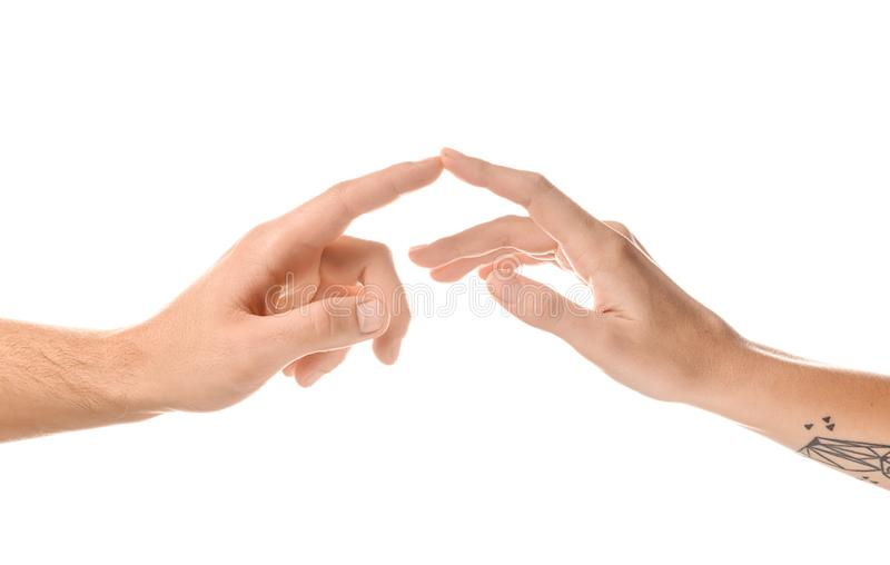 Man and woman touching fingers on white background stock photos