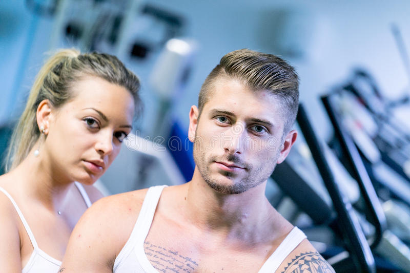 Man and woman trainers in a gym stock photos