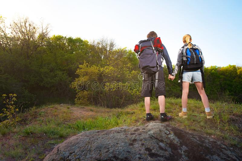 Man and woman traveler outdoors.Couple of Hikers holding their h royalty free stock photos