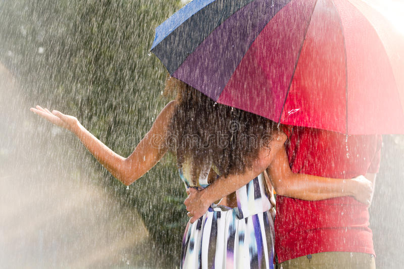 Man and woman under umbrella stock images