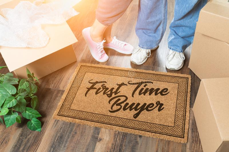 Man and Woman Unpacking Near Our First Time Buyer Welcome Mat, Moving Boxes and Plant. Man and Woman Unpacking Near Our First Time Buyer Welcome Mat, Moving stock image