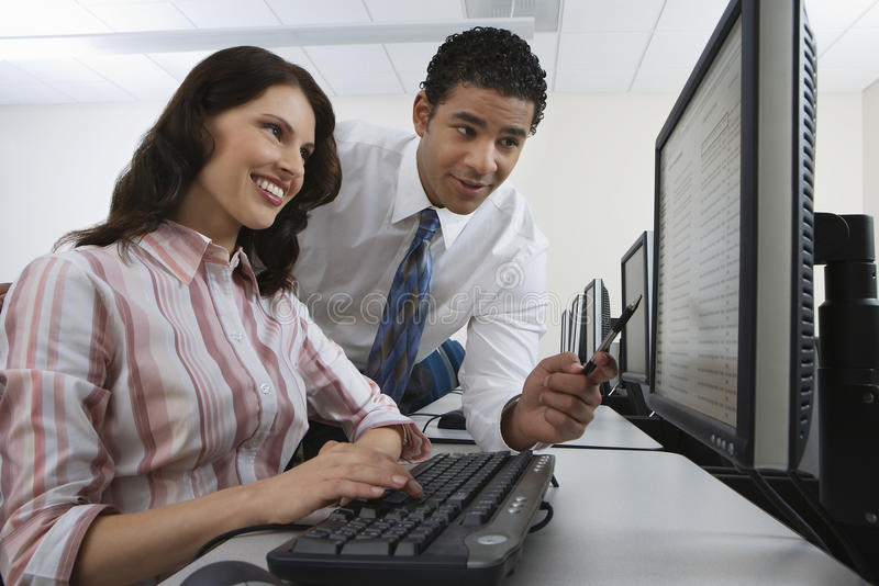 Man And Woman Using Computer stock photo