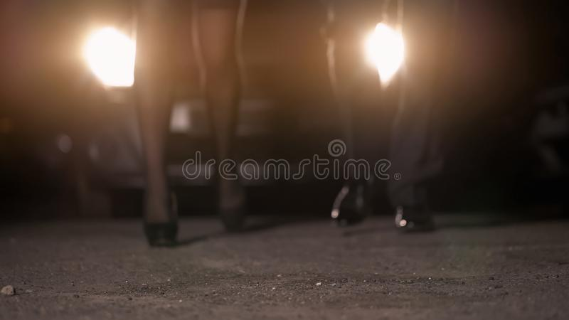 Man and woman walking to night club together, flirting and dancing, night life stock images