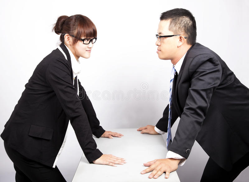 Man and woman war. Businessman and woman war in office stock photography
