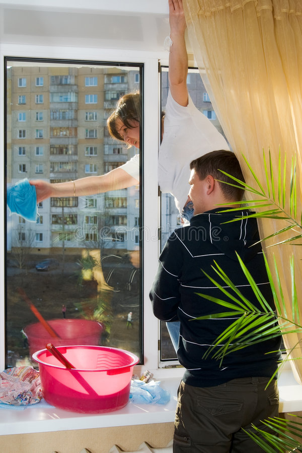 Download A Man And Woman Wash A Window Stock Photo - Image: 9033082