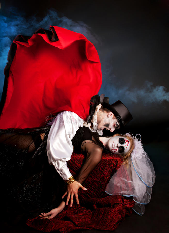 Man and woman wearing as vampire and witch. Halloween royalty free stock image