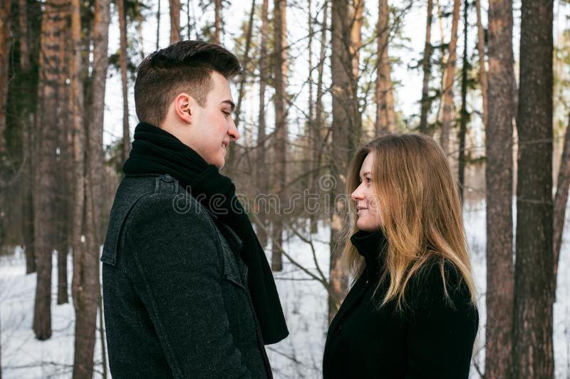 Man and Woman Wearing Black Coats Standing Near Snow-covered Trees royalty free stock photo