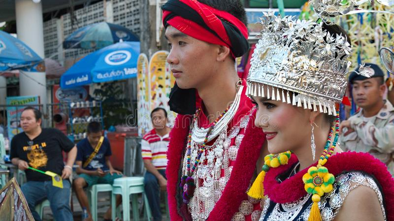 Man and Woman wearing a traditional China`s Yunnan dress in the parade for promoted 46th Thailand National Games. Chiang Rai, Thailand – October 28, 2018 royalty free stock photo