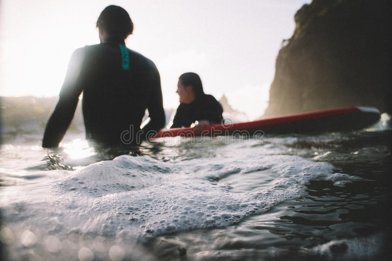 Man And Woman In Wet Suit On Body Of Water During Daytime Free Public Domain Cc0 Image