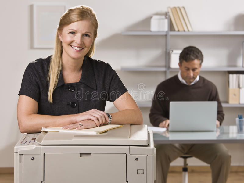 Download Man And Woman Working In Office Stock Image - Image: 10011477
