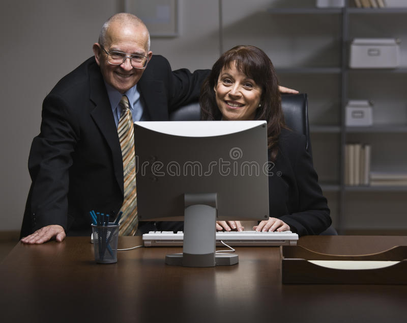 Download Man And Woman Working In Office Stock Photo - Image of formal, desk: 10012064