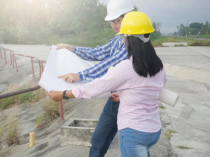 The man and woman are working on place. royalty free stock image
