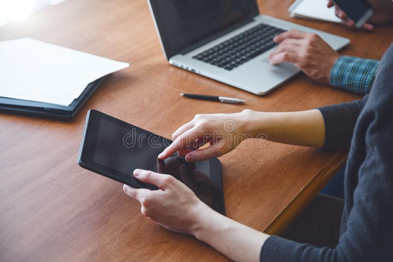 Man and woman working together with digital tablet. And laptop royalty free stock photos
