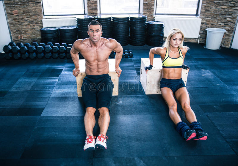 Man and woman workout with hands on fit box royalty free stock images