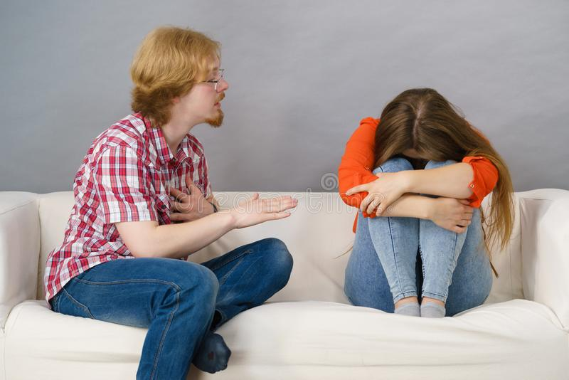 Woman and man after argue on sofa royalty free stock photos
