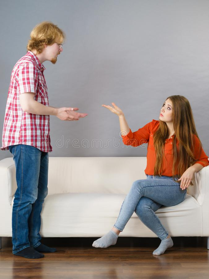 Woman and man after argue on sofa. Man and women being mad, ignoring each other after fight. Friendship, couple breakup difficulties and problems concept royalty free stock photo