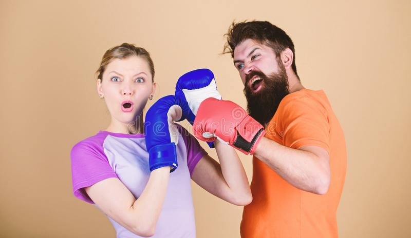 Man and woman in boxing gloves. Boxing sport concept. Couple girl and hipster practicing boxing. Sport for everyone stock photo