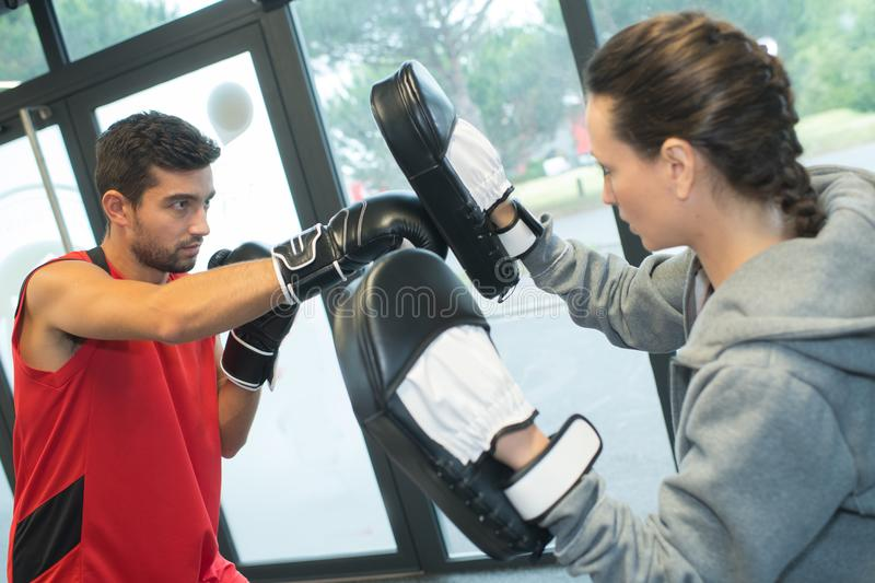 Man and woman in boxing practice stock photo