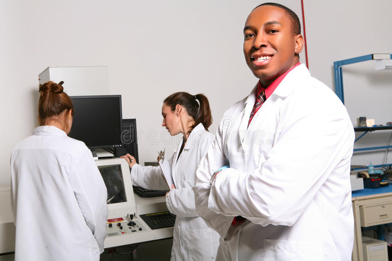 Man and Women Computer Technicians stock photography