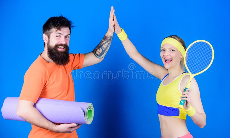 Man and woman couple in love with yoga mat and sport equipment. Fitness exercises. Workout and fitness. Girl and guy stock photography