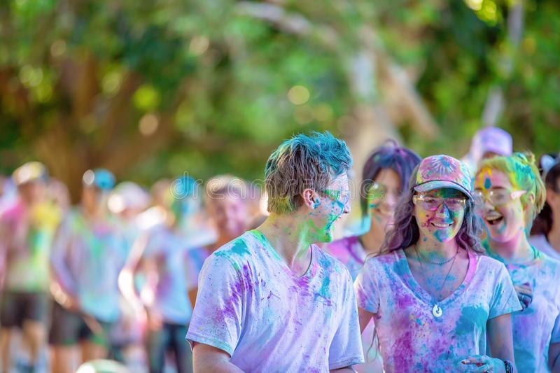 Man And Women Covered In Colored Powder Laughing In Fun Run stock image