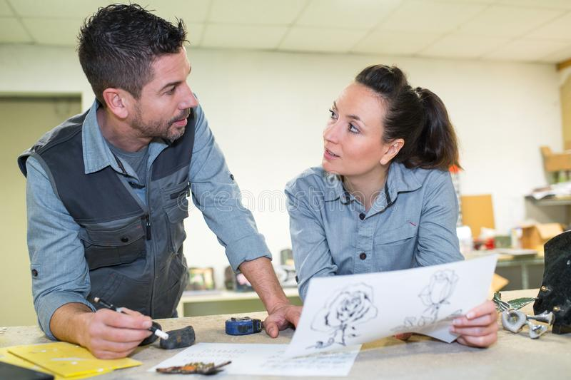 Man and women designing in studio royalty free stock images