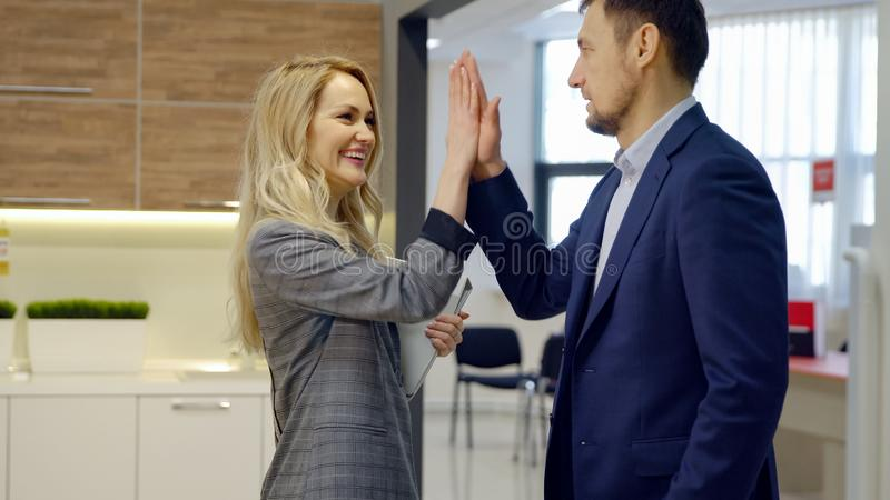 Man and a woman discuss important issues of the forthcoming work royalty free stock images