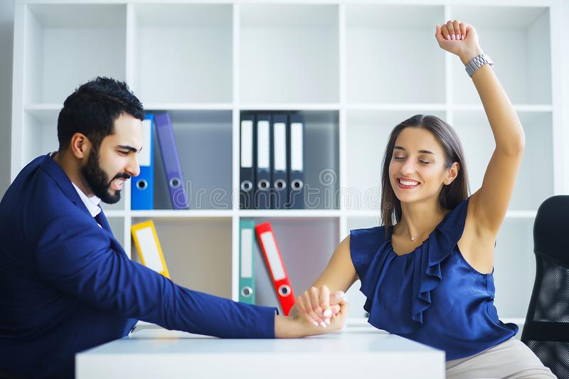 Man and woman doing arm wrestling. Man and women doing arm wrestling stock photos
