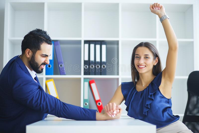 Man and woman doing arm wrestling. Man and women doing arm wrestling stock photography