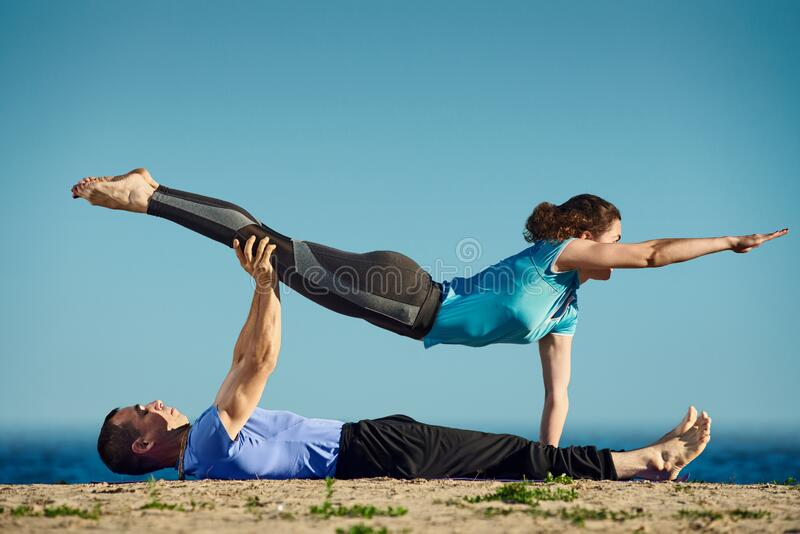 Couple yoga training stock photography