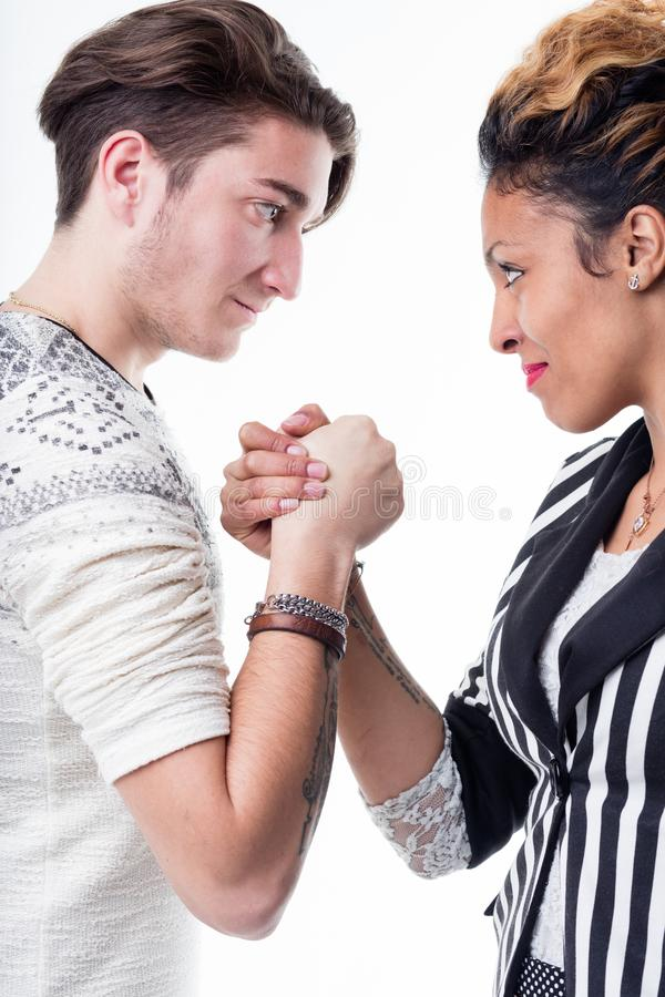 Man and woman facing off in a battle of wills royalty free stock photo