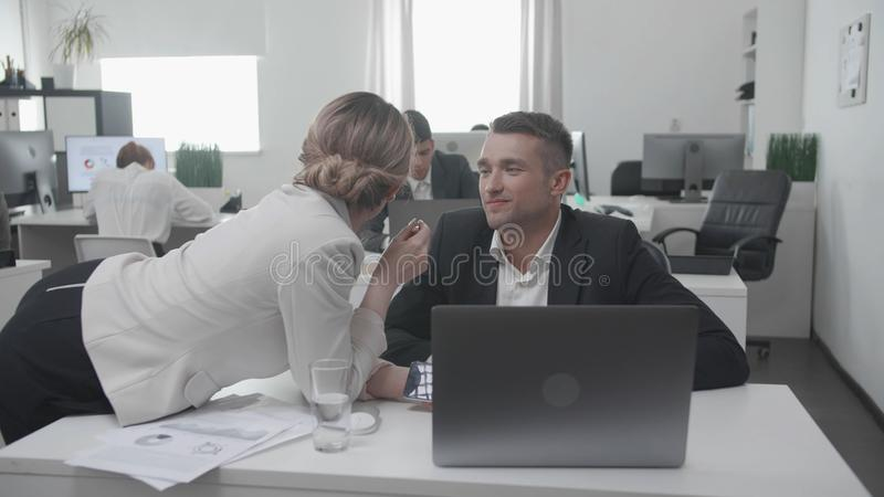 Workday at the office, collegues flirt with each other. stock images