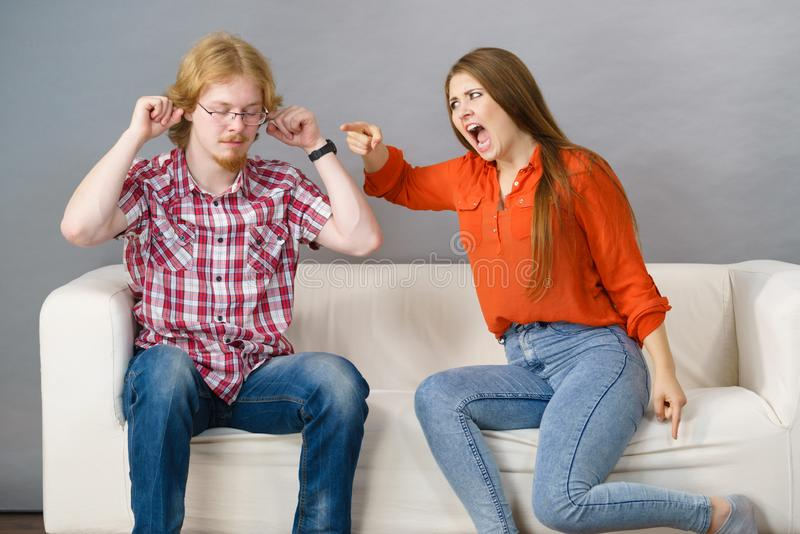 Man and woman having fight. Man and women having conflict. Female ignoring what her boyfriend is saying. Friendship, couple breakup difficulties and problems stock photos