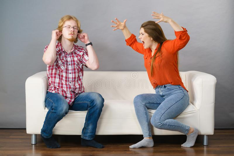 Man and woman having fight. Man and women having conflict. Female ignoring what her boyfriend is saying. Friendship, couple breakup difficulties and problems royalty free stock images
