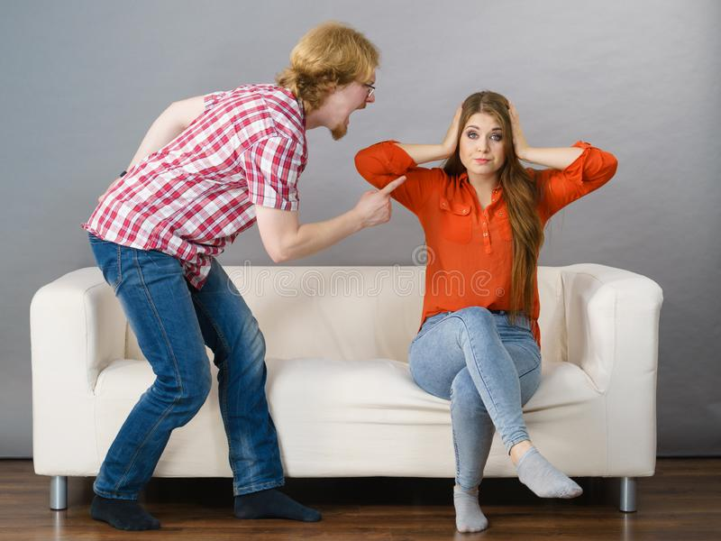 Man and woman having fight. Man and women having conflict. Guy ignoring what his girlfriend is saying. Friendship, couple breakup difficulties and problems stock images