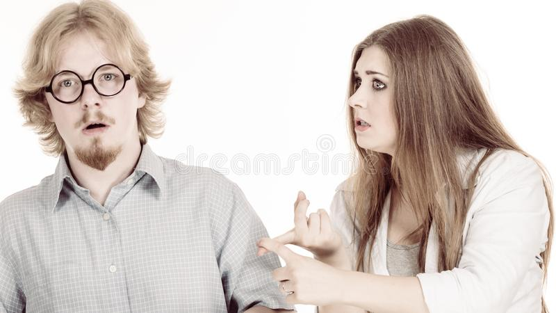 Woman complaining to her boyfriend. Man and women having horrible fight. Friendship, couple breakup difficulties and problems concept royalty free stock images