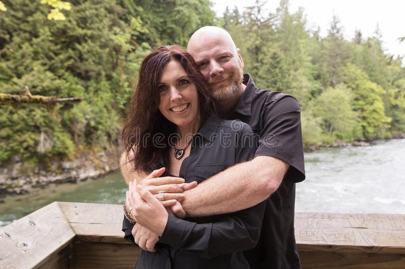 Happy Couple at a river. Man and women hugging near a river royalty free stock image