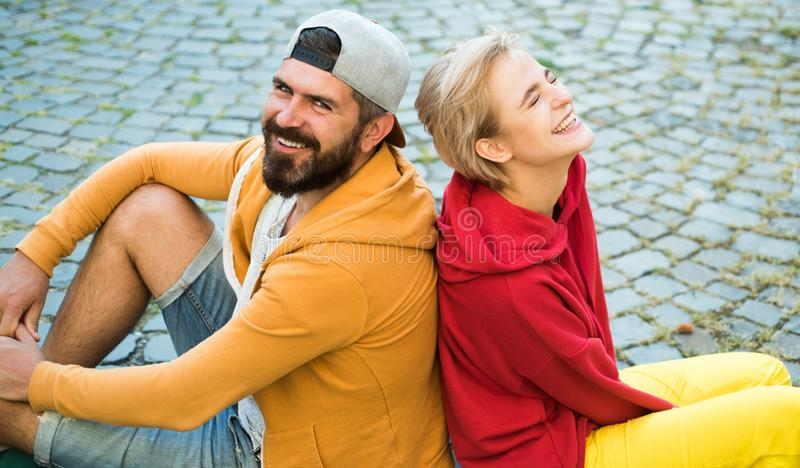 Man and woman modern clothes for youth relaxing outdoors. Forever young. Couple hang out together. Carefree people stock photos
