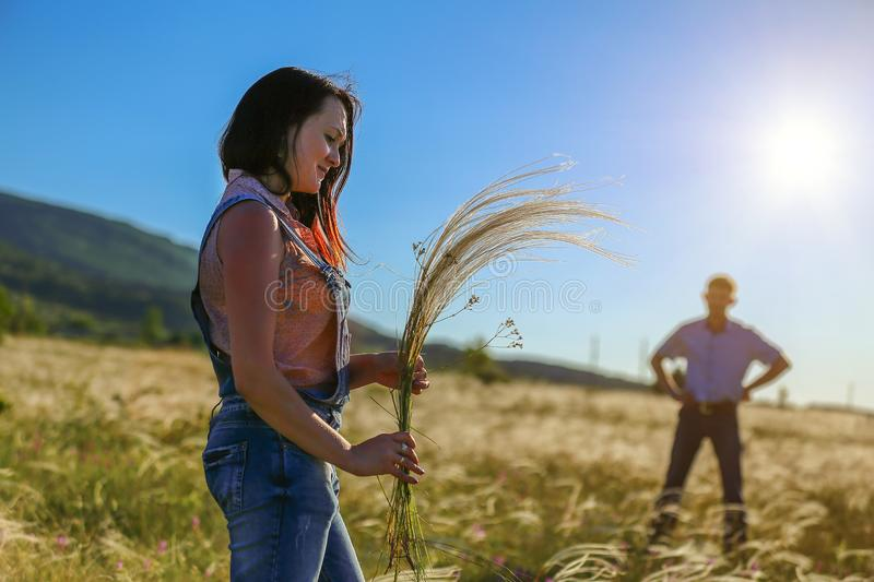 Man and woman in nature in the sun, the relationship between loved ones man and woman in nature in the sun, the relationship. Man and women in nature in the sun royalty free stock photos