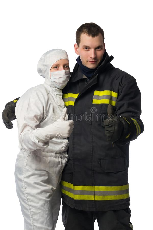 Man and woman in protective suits are holding their thumbs up, over white background. Man and women in protective suits are holding their thumbs up, over white royalty free stock photography
