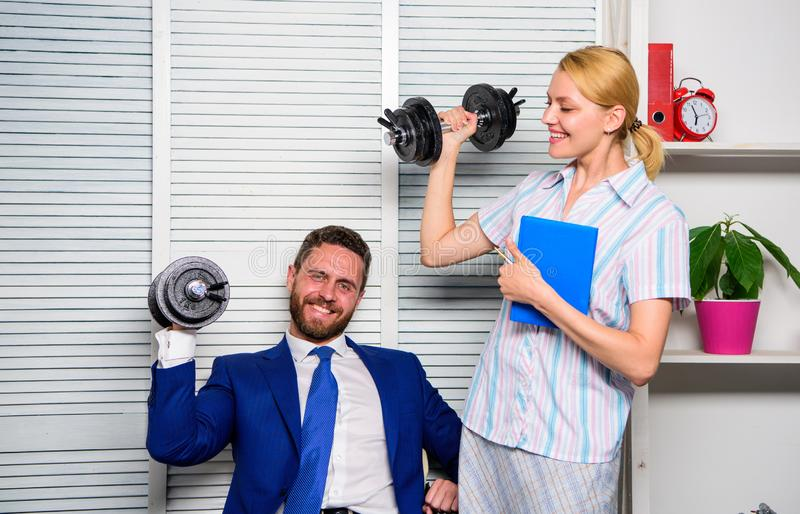 Man and woman raise heavy dumbbells. Strong powerful business strategy. Good job concept. Boss businessman and office. Man and women raise heavy dumbbells stock images