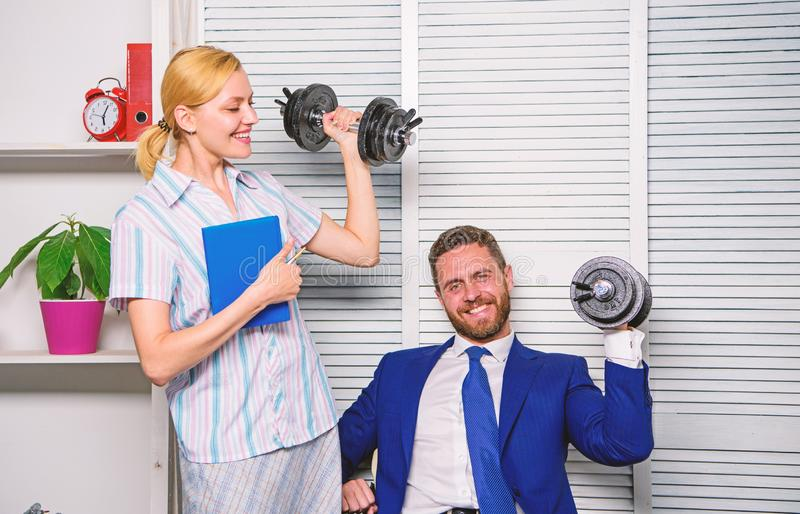 Man and woman raise heavy dumbbells. Strong powerful business strategy. Good job concept. Boss businessman and office. Man and women raise heavy dumbbells royalty free stock photos